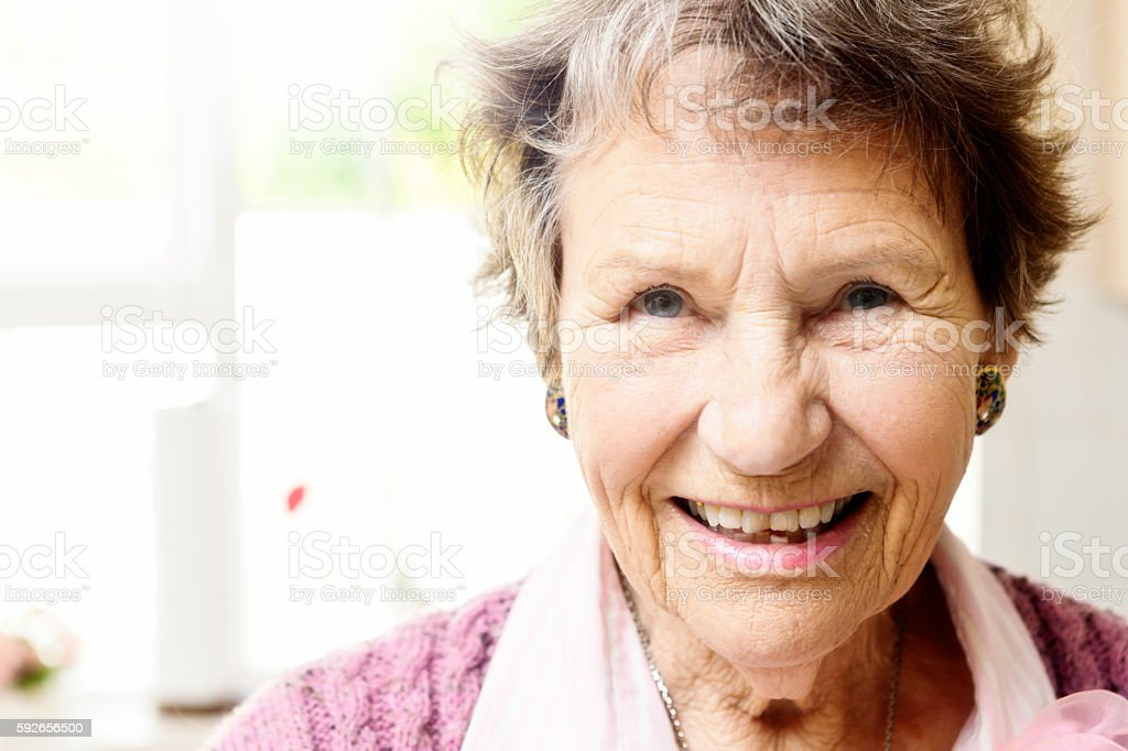 Portrait of brightly smiling senior woman with copy space stock photo