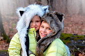 Portrait of brothers wearing animal hats outdoors