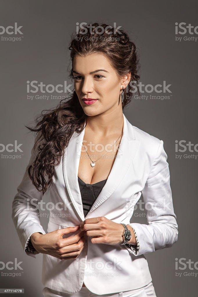 Portrait of brunette beautiful girl posing in white dress stock photo