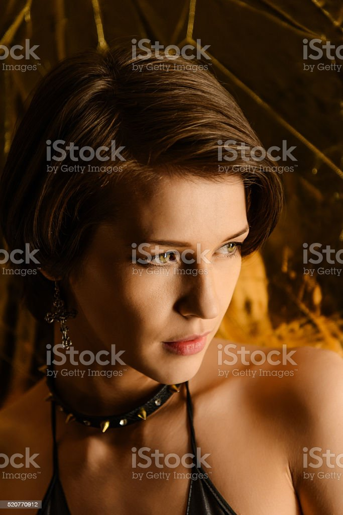 Portrait of  brunette wearing a collar with spikes stock photo