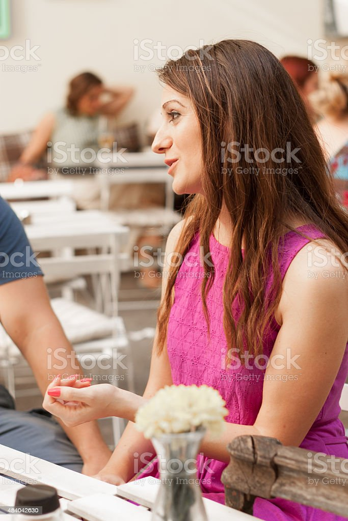 Portrait of brunette woman in cafe stock photo