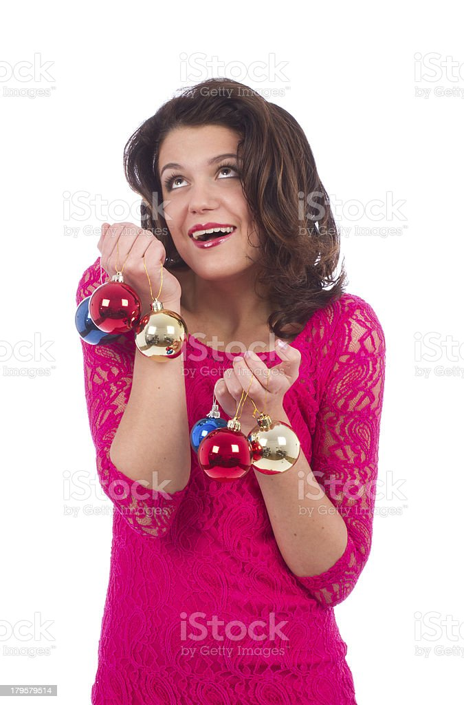 Portrait of brunette woman playing with decoration balls royalty-free stock photo