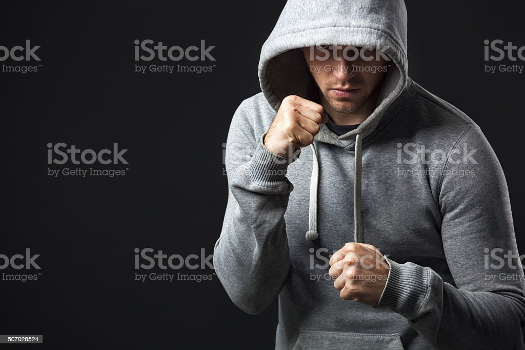 Portrait of brutal looking young guy ready to fight. stock photo