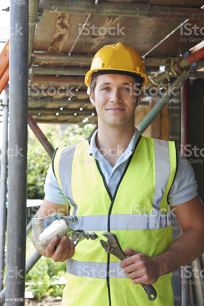 Portrait Of Builder Putting Up Scaffolding royalty-free stock photo
