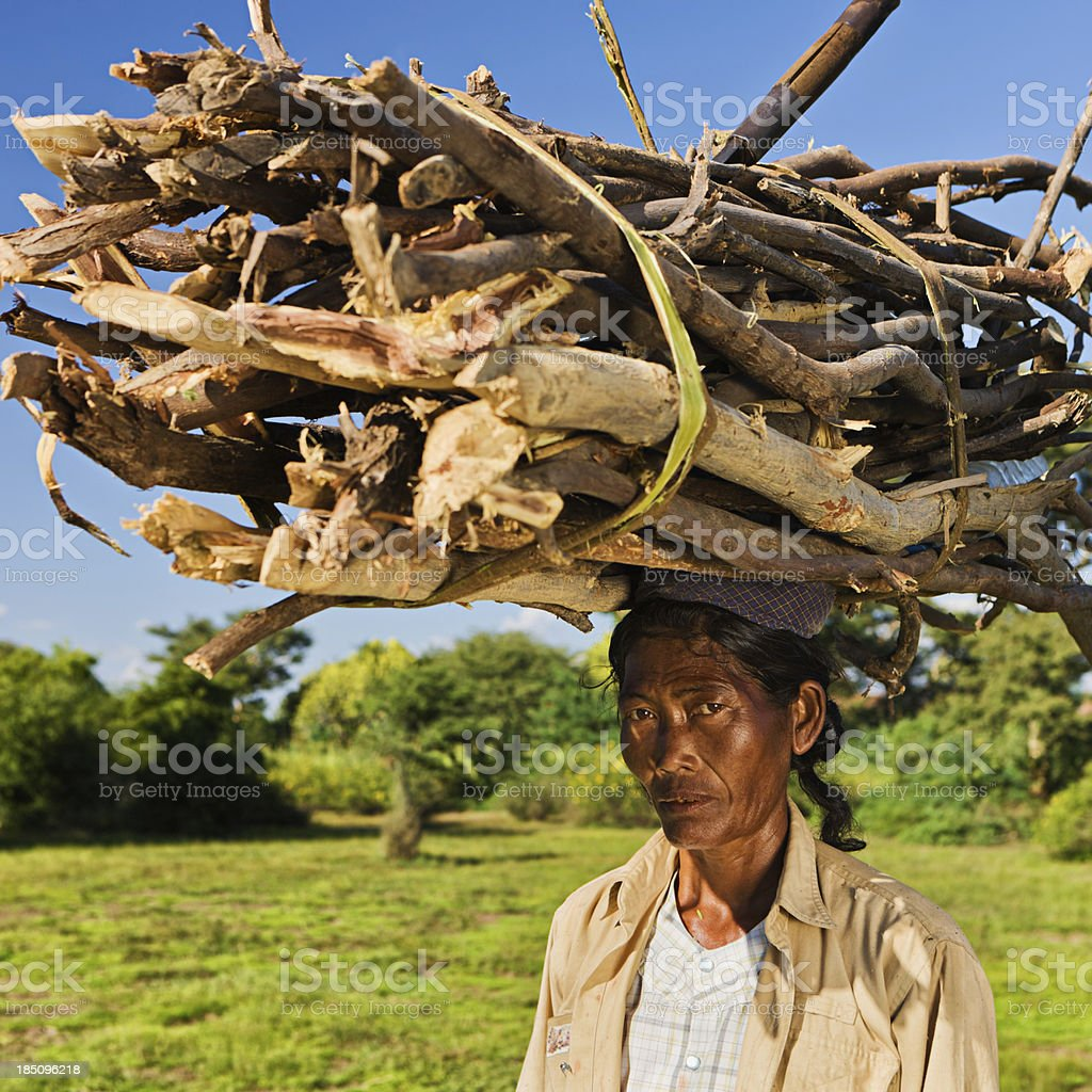 Portrait of burmese woman carrying brushwood stock photo