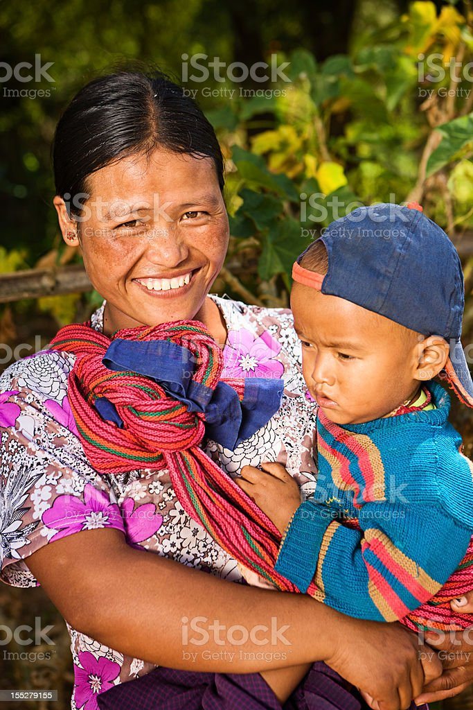 Portrait of burmese woman holding her baby royalty-free stock photo