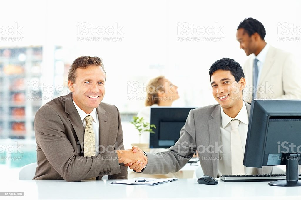 Portrait of business colleagues shaking hands with each other royalty-free stock photo