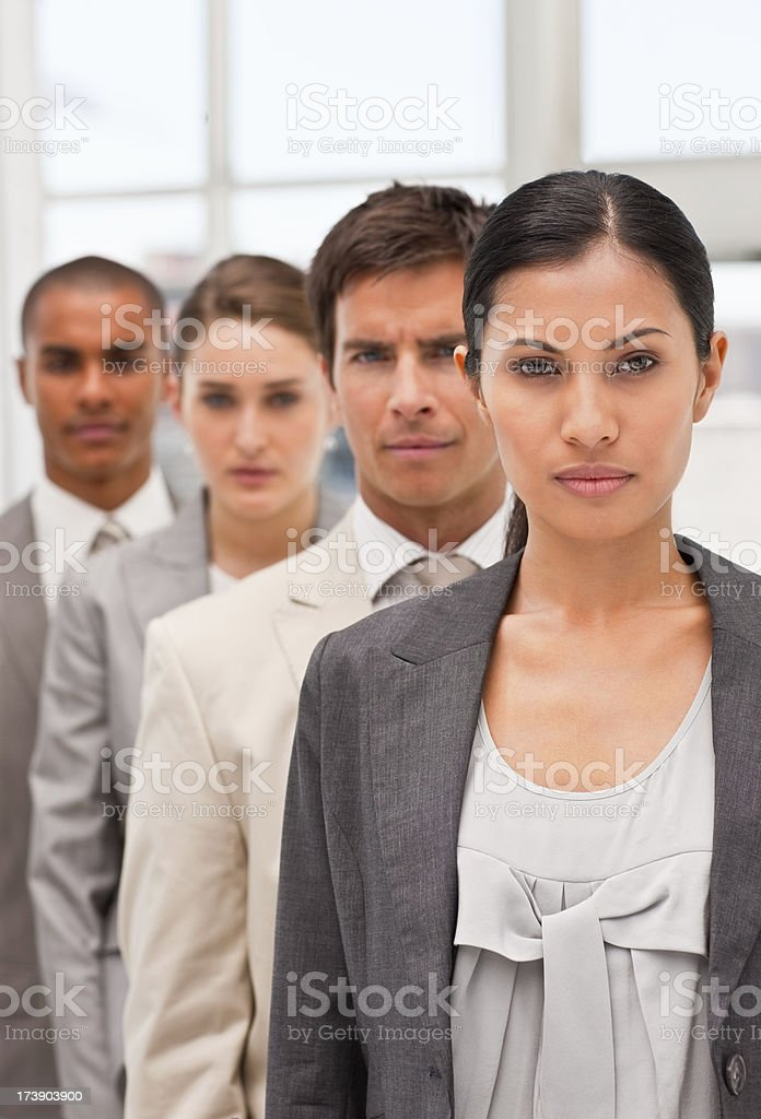 Portrait of business colleagues standing in a row royalty-free stock photo