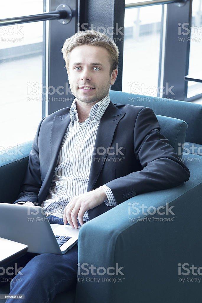 Portrait of business man using laptop stock photo