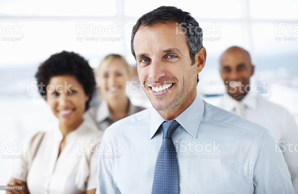 Portrait of business people standing in group stock photo