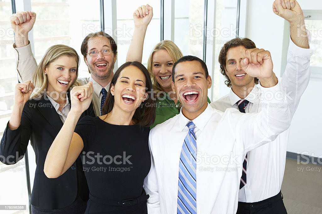 Portrait Of Business Team In Office Celebrating stock photo