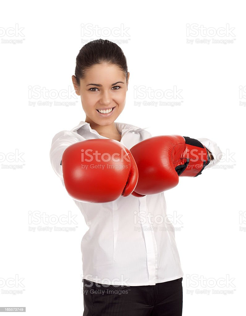 Portrait of business woman wearing boxing gloves royalty-free stock photo