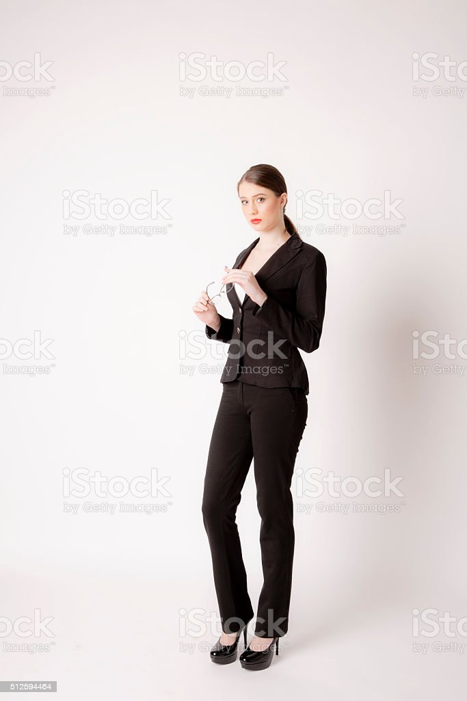 Portrait of business woman with glasses on a white background. stock photo