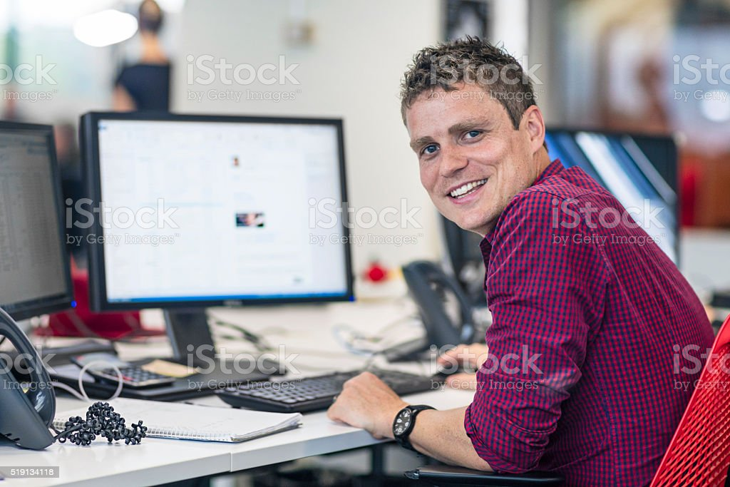 Portrait of businessman at his desk in the office stock photo