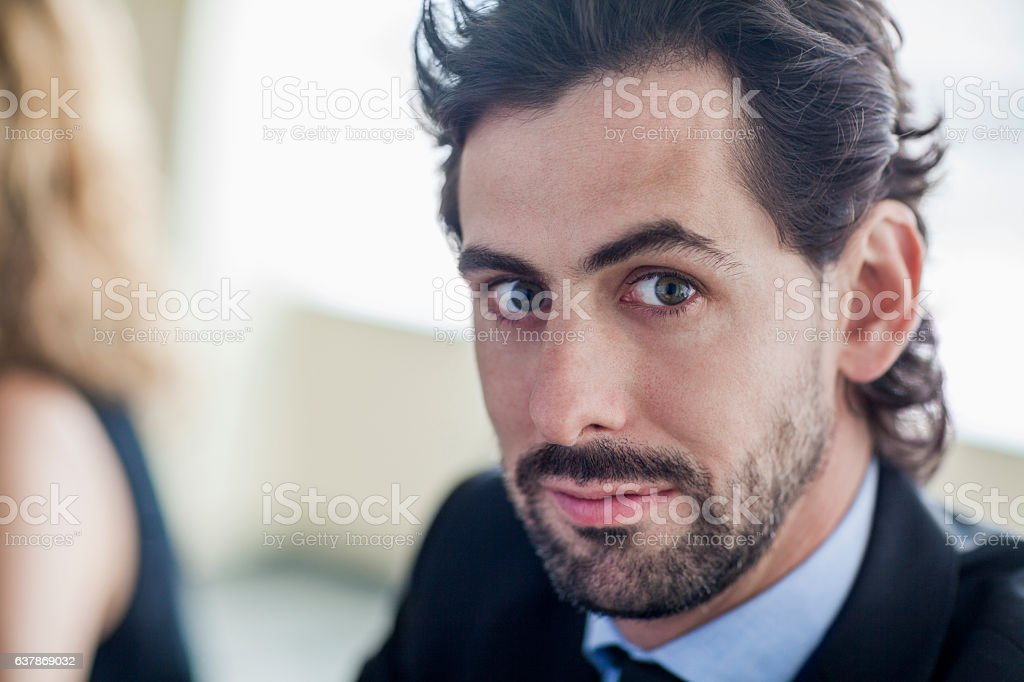 Portrait of businessman meeting in office stock photo