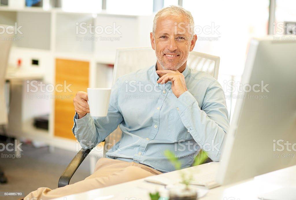 Portrait of businessman near his desk stock photo