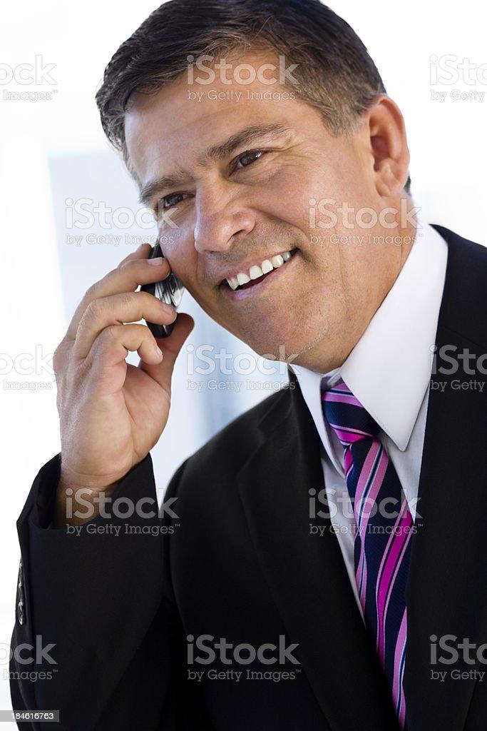Portrait of businessman on mobile phone stock photo