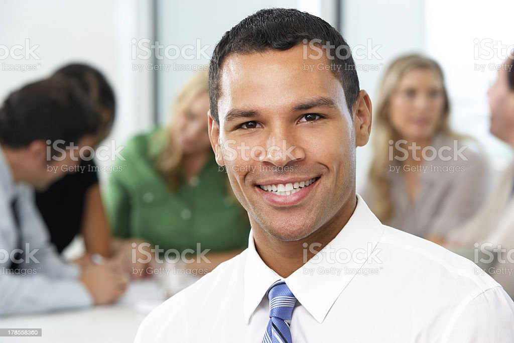 Portrait Of Businessman Sitting At Boardroom Table royalty-free stock photo