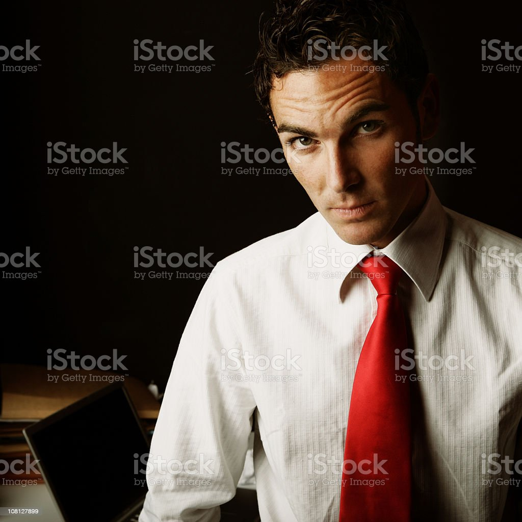 Portrait of Businessman Standing Near Desk royalty-free stock photo