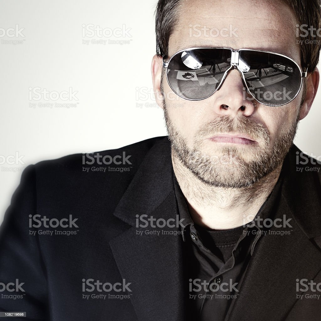 Portrait of Businessman Wearing Sunglasses on White Background stock photo