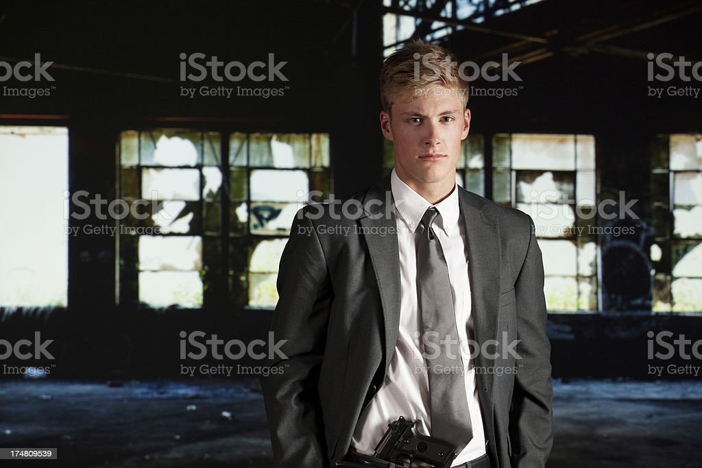 Portrait of businessman with a handgun royalty-free stock photo