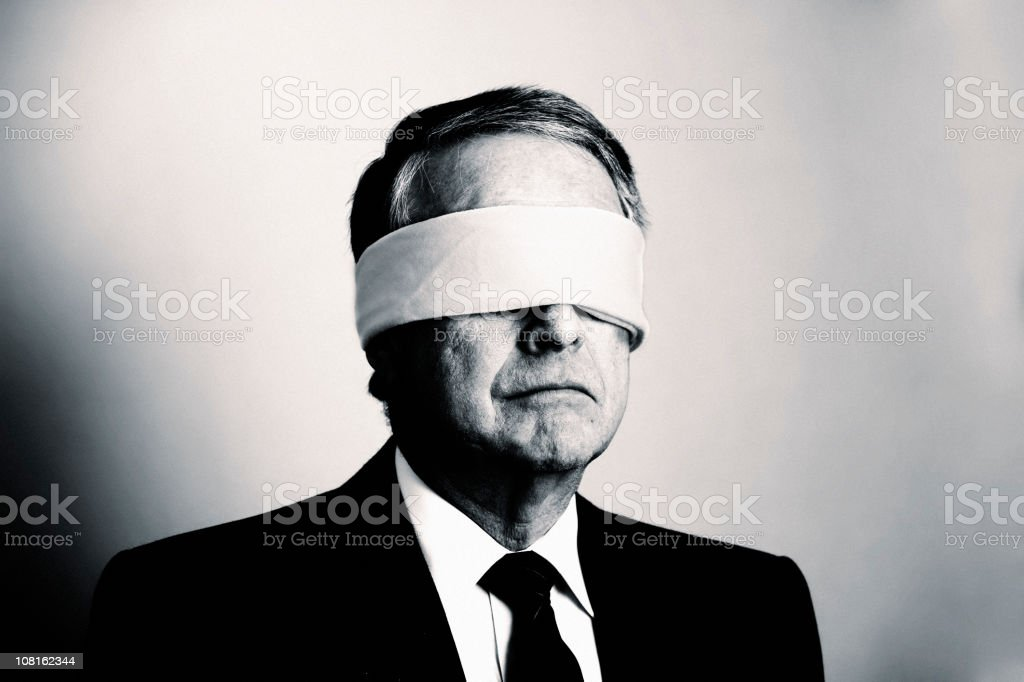 Portrait of Businessman with Blindfold On, Black and White royalty-free stock photo
