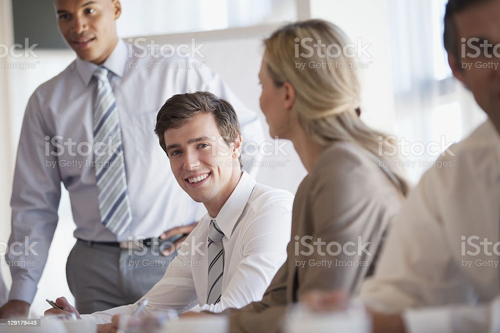 Portrait of Businessman with colleagues in conference room royalty-free stock photo