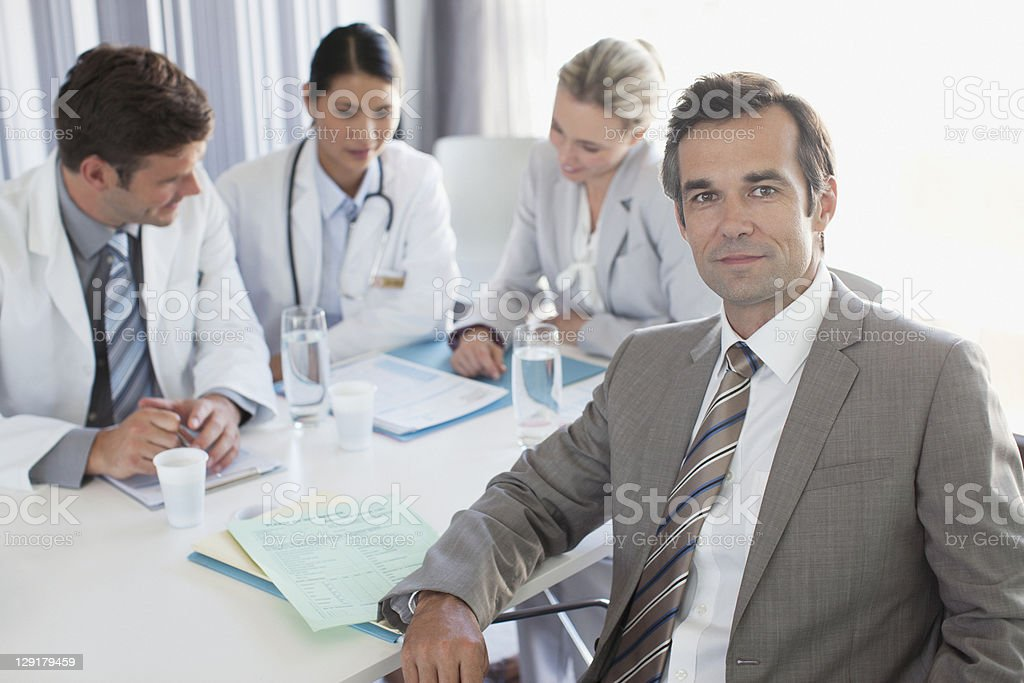 Portrait of businessman with doctors royalty-free stock photo