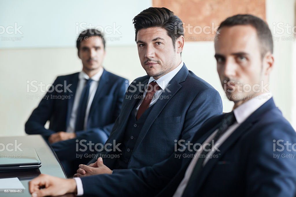 Portrait of businessmen in office conference room stock photo