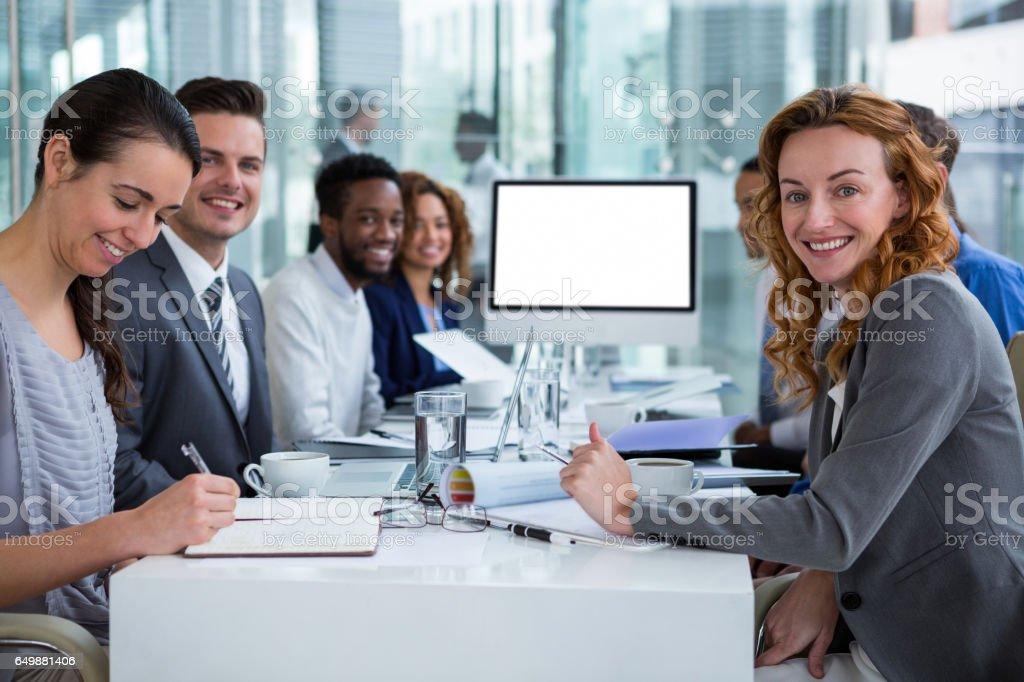 Portrait of businesspeople during video conference stock photo