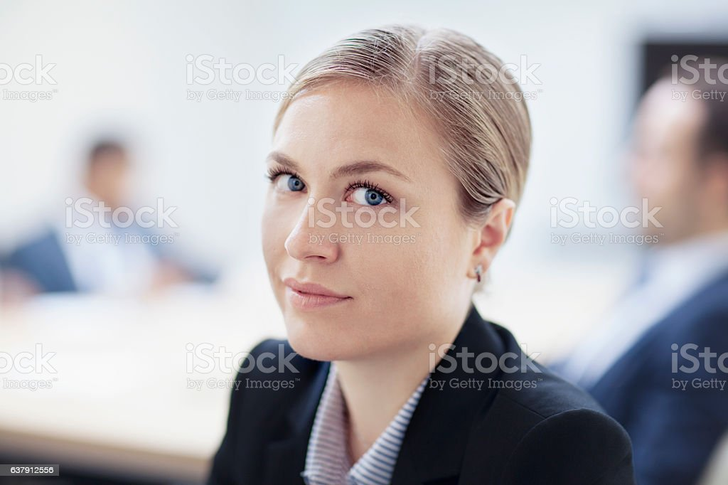 Portrait of businesswoman in meeting stock photo