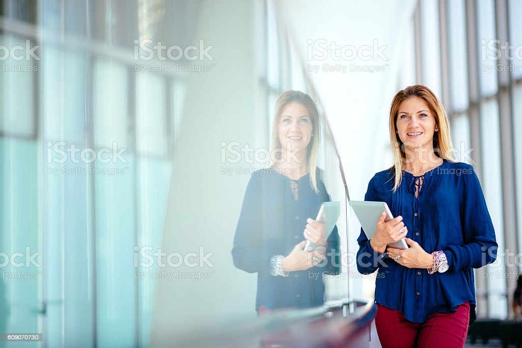 Portrait of businesswoman, smiling and expressing positivity stock photo