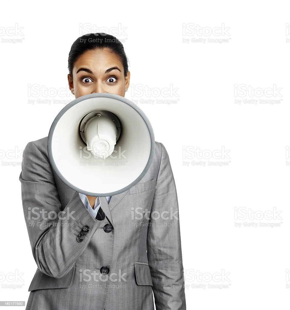 Portrait of businesswoman speaking in a megaphone royalty-free stock photo