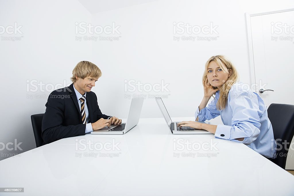 Portrait of businesswoman with coworker working in office royalty-free stock photo