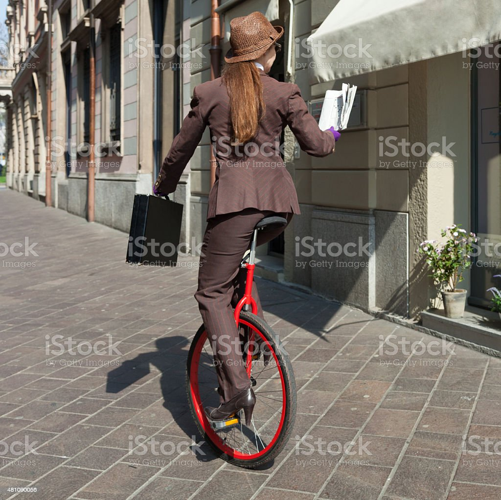 portrait of businesswoman with unicycle stock photo