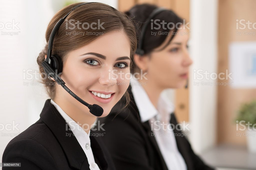 Portrait of call center worker accompanied by her team stock photo