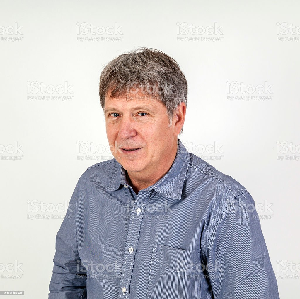 portrait of casual dressed man posing in studio stock photo