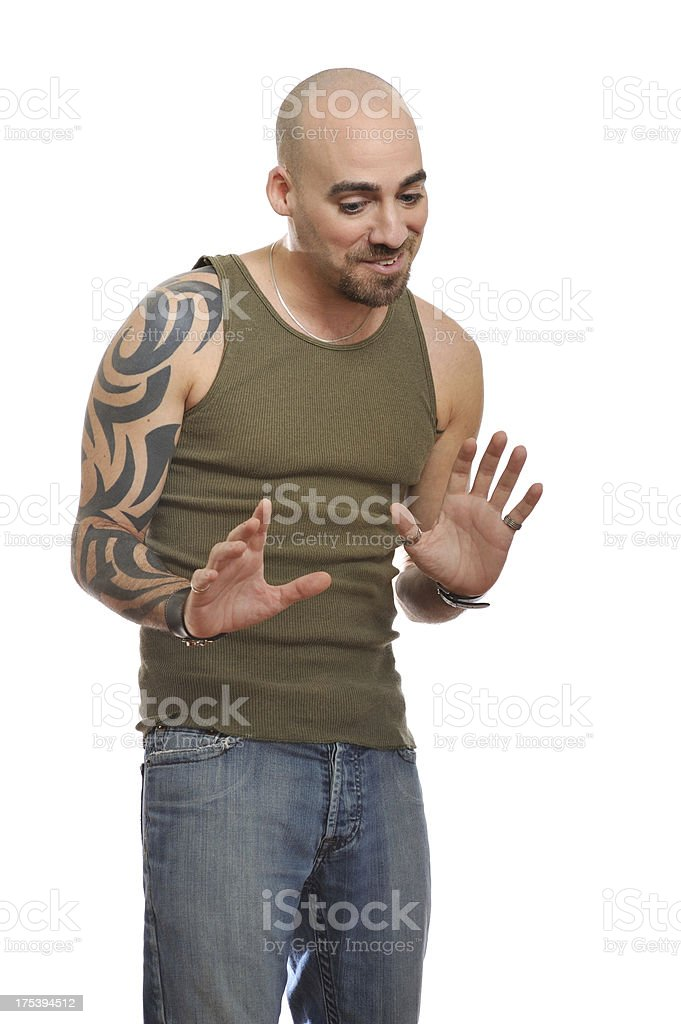 Portrait of casual man with tattoo and shaved head royalty-free stock photo