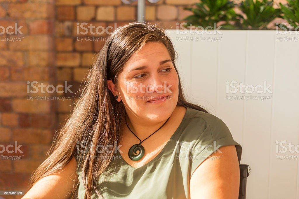 Portrait of Casually Dressed Maori Islander Business Woman Meeting stock photo