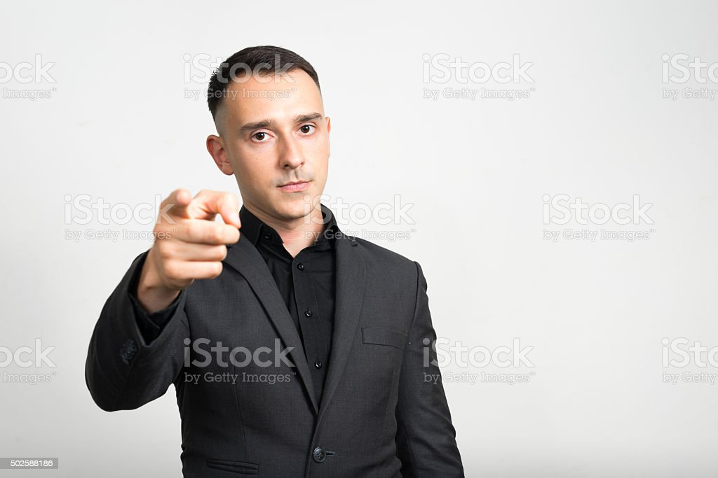 Portrait of Caucasian businessman pointing finger at you stock photo