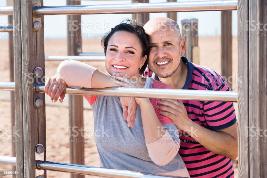 Portrait of charming couple embracing outdoors stock photo
