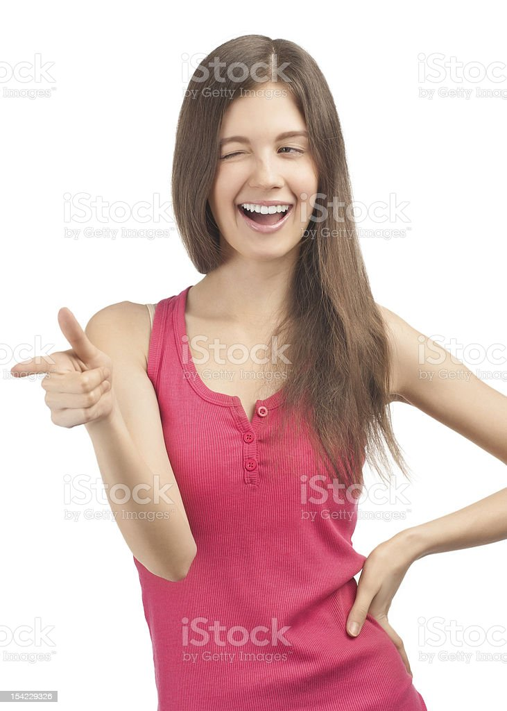 Portrait of cheerful casual girl pointing royalty-free stock photo