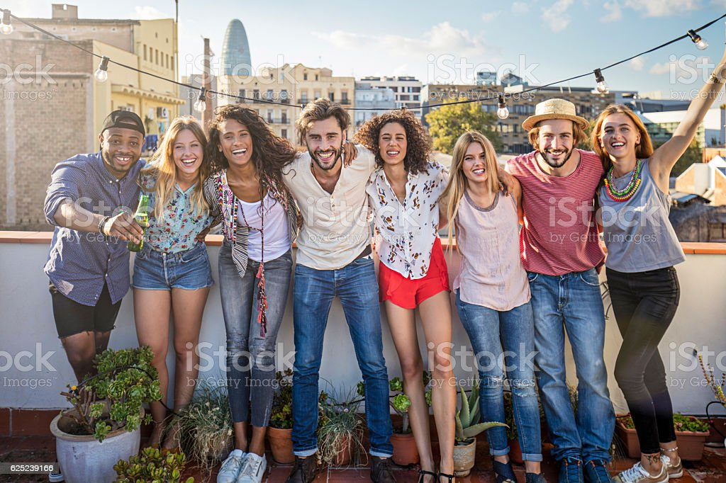 Portrait of cheerful friends standing on terrace stock photo