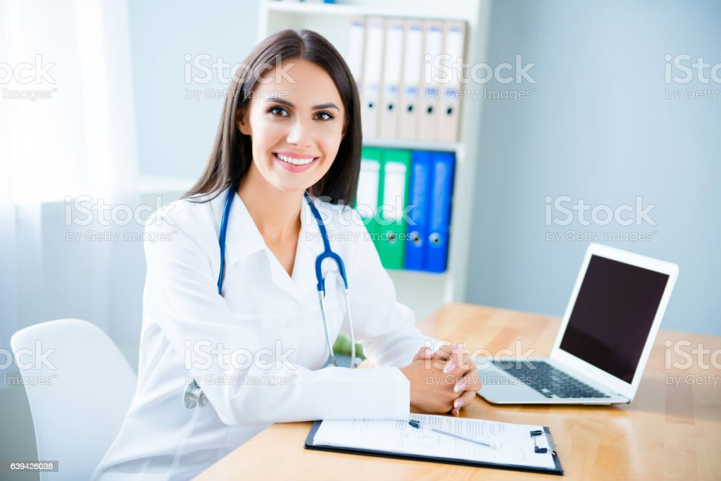 Portrait of cheerful happy female doctor on consultation stock photo