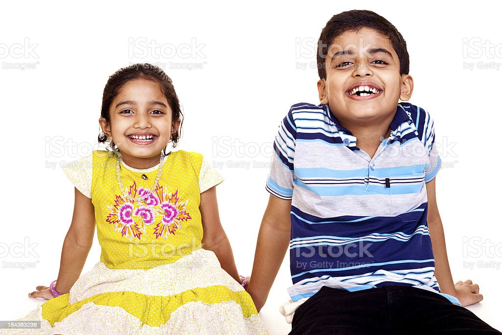 Portrait of Cheerful Indian Brother and Sister Isolated on White royalty-free stock photo