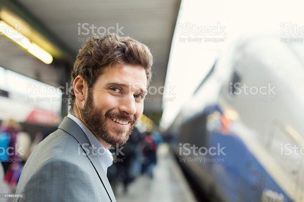 Portrait of cheerful man on railway station platform. Looking camera stock photo