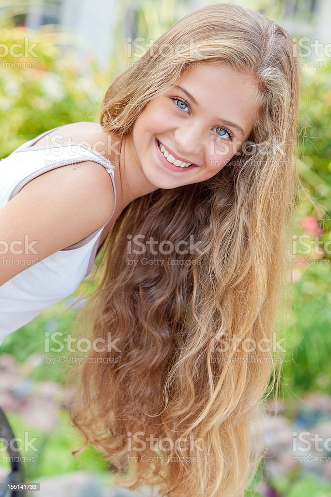 Portrait of cheerful teenage girl posing, smiling expressing positivity outdoors royalty-free stock photo