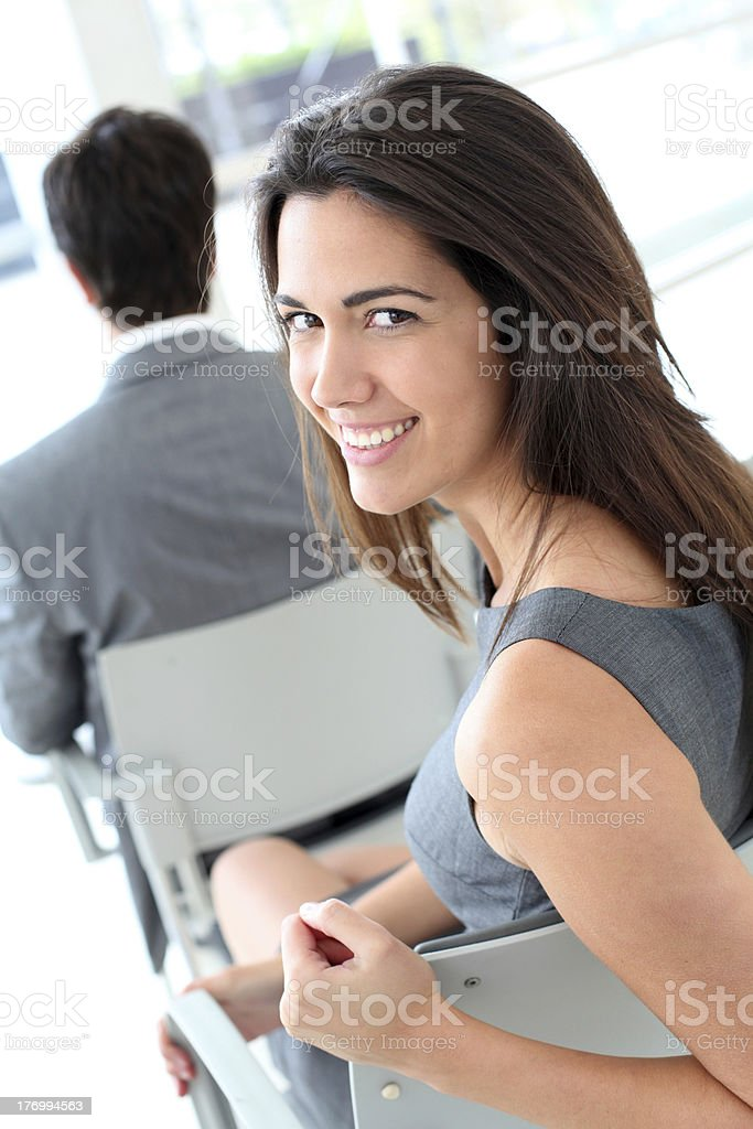 Portrait of cheerful woman attending meeting royalty-free stock photo