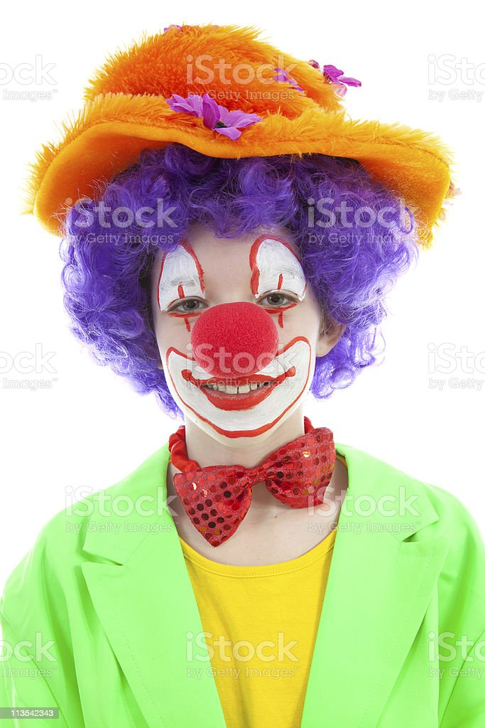 portrait of child dressed as colorful funny clown stock photo