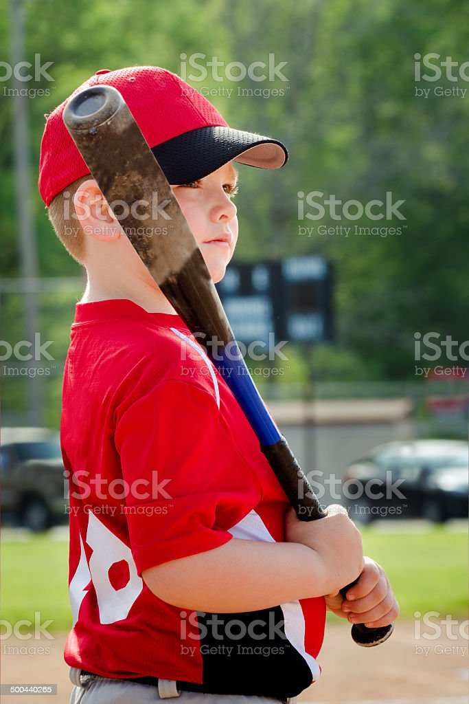 Portrait of child preparing to bat in game stock photo